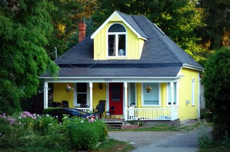two houses sightlines two yellow houses with doors