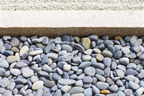 prevent weeds  growing  rocks home
