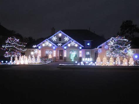christmas light guys hung all the eaves and snowflakes