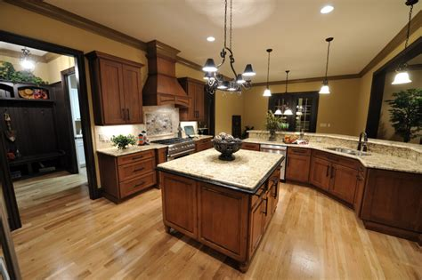kitchens  brown cupboards kitchen  dark floors