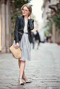 Picture Of With black blazer light gray dress and beige clutch