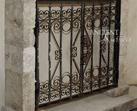antique rough iron fireplace gates  ancient surfaces
