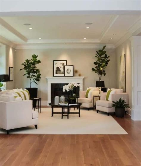 White living room boasts sleek sofas and chairs along with