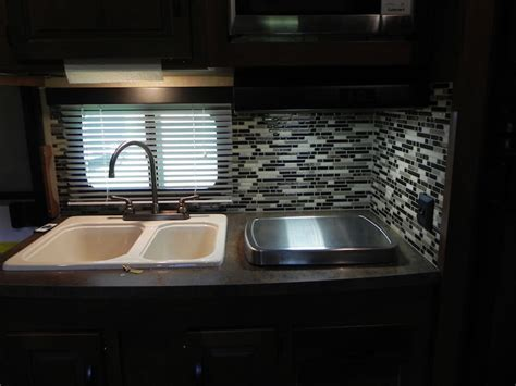 Camper's Kitchen And Bathroom Get Adhesive Tiles