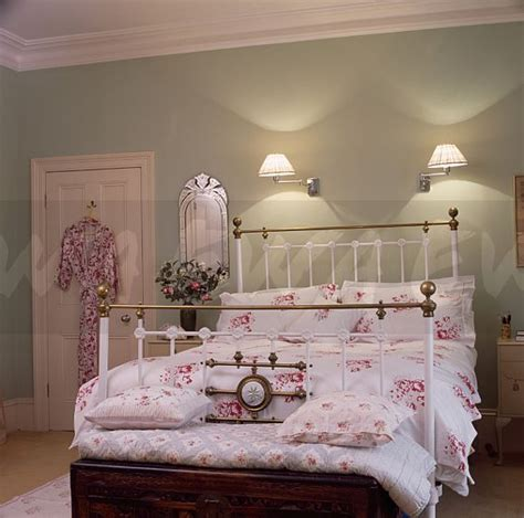 image wall lights above white antique brass bed bewith