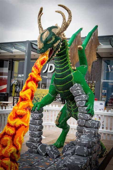 metre high lego dragon sculpture  greeting shoppers