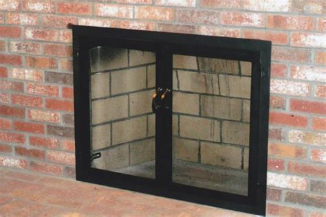 black wrought iron attached fireplace mesh door screens