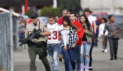 In This Oct. 24, 2014 Photo, Students Are Escorted To