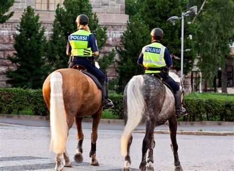 girls policeman   horse  helsinki finland