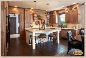 painting a kitchen island cabinets showplace inset cabinetry in maple vintage nutmeg creates a tasty setting