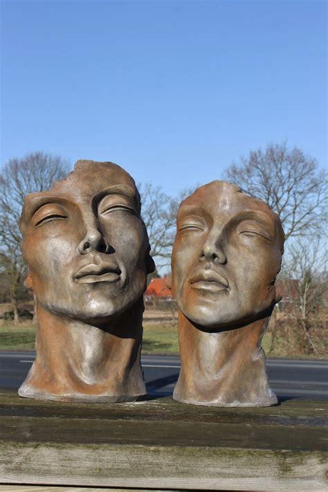skulptur set gesicht mann und frau klein rosteffekt