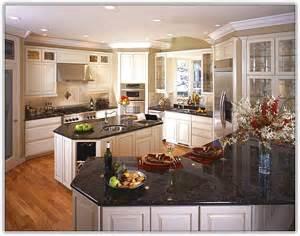 kitchen island with drop leaf antique white kitchen cabinets with black granite
