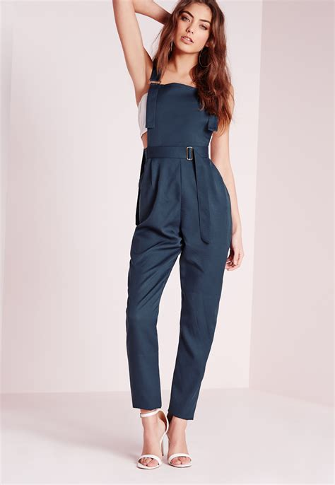 navy jumpsuit lyst missguided strappy dungaree d ring jumpsuit navy in