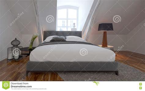 chambre sous pente de toit intérieur de chambre à coucher avec le lit sous une pente