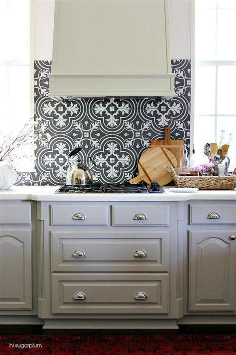 backsplash for black and white kitchen black and white mosaic tile kitchen backsplash with gray kitchen hood transitional kitchen