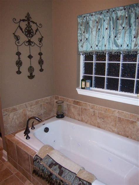 drop  soaking tub  corner faucet master bath