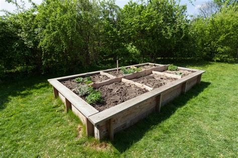 elevated garden bed how to build a raised garden bed planning building and