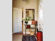 Welcoming Entryway With Textured Walls and WindowPaned