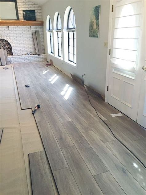 Types Of Floor Coverings For Bedrooms by Laminate Flooring Flooring And Green Notebook On