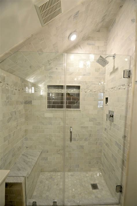 tiny bathroom remodel features carrara marble shower