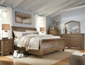 Trishley Light Brown Sleigh Bedroom Set From Ashley