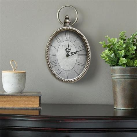 Stratton home decor brushed gold flowing leaves wall decor. Stratton Home Decor Antique Silver Oval Wall Clock-S09595 - The Home Depot