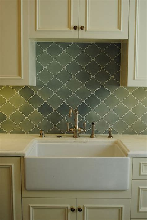 green tile backsplash kitchen cabinets brass hardware green arabesque tile