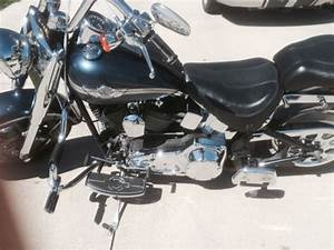 The harley is blue great condition softail and has