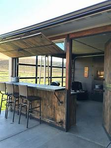 Fun Out door space with bar and sunroom. Glass garage door ...