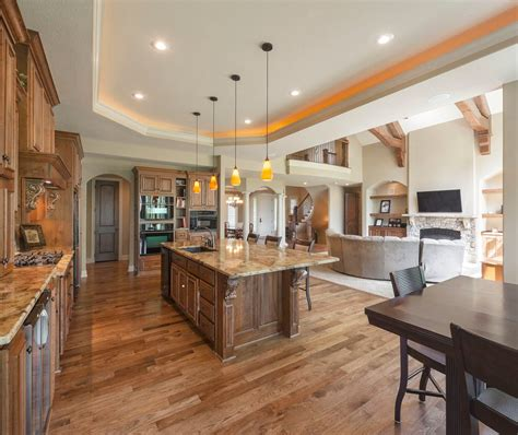 open concept ranch homes living room contemporary  wood ceiling blade ceiling fans