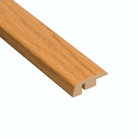 home depot flooring reducers home legend tacoma oak 7 16 in thick x 1 5 16 in wide x 94 in length laminate carpet reducer