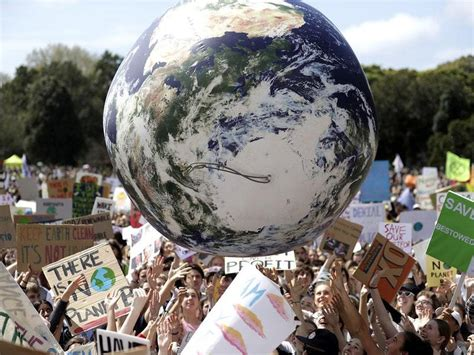 Tens of thousands join climate change protests across ...