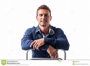 Smiling Young Man Sitting On Chair Backwards Stock Photo ...