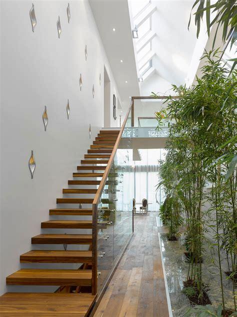 modern custom home  central atrium  interior bamboo