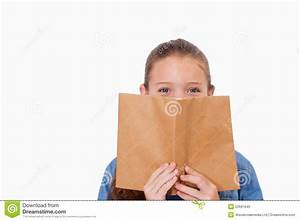 Girl Hiding Her Face Behind A Book Royalty Free Stock ...