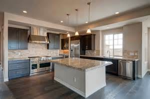white kitchen cabinets with black island 57 luxury kitchen island designs pictures designing idea