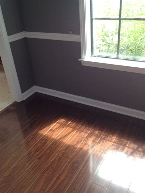 seal gray paint  white trim  dark laminate floor