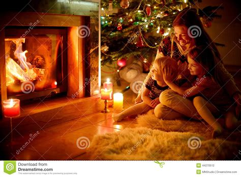 happy family   fireplace  christmas stock photo