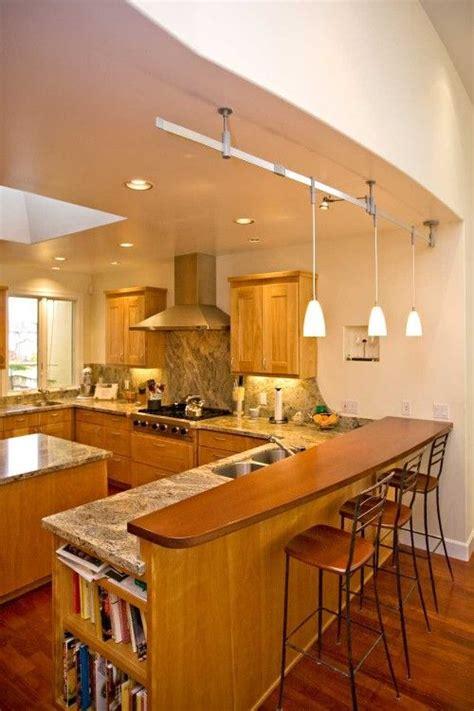 peninsula  granite counter  wood bar bar