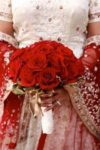 Red Rose Bouquet Against Red And Gold Indian Bridal Lehnga
