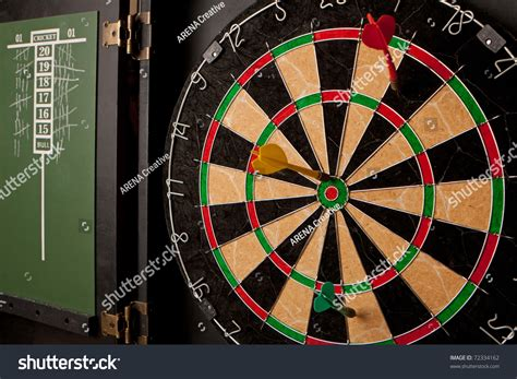 A Professional Dart Board Enclosed In A Cabinet With Slate