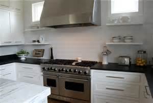 White Cabinets Black Countertop with Backsplash