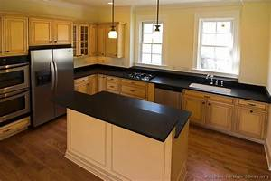 Pictures of kitchens traditional off white antique for Kitchen designs with white cabinets and black countertops