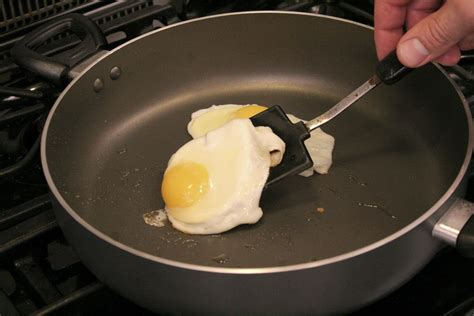 cooking eggs fried egg pan flipping without rare done
