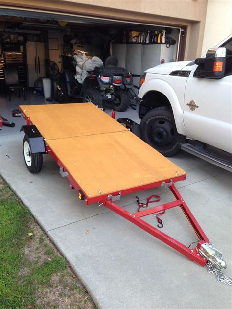 Foldable Boat Assembly by Folding Trailer Solves Storage And Transportation