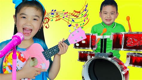 Hana & Lyndon Pretend Play With Guitar & Drum Toys And