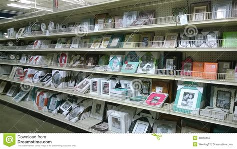 picture frames on shelves selling at store editorial stock