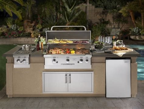 photo cuisine exterieure jardin barbecue fixe fonctionnel et esthétique dans le jardin moderne