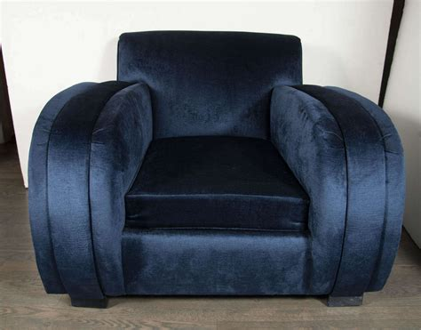 deco streamlined club chair in navy blue velvet
