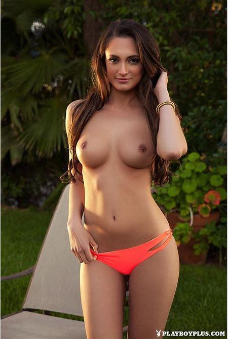 Deanna Greene loses her orange bikini and poses in the nude